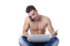 Shirtless young man overwhelmed by technology: PC, tablet, phones Stock Photos