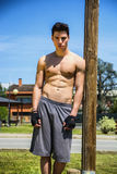 Shirtless young man resting after workout outdoor Stock Images