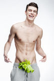 Shirtless young man with salad in pants Stock Photography