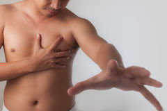 Shirtless young man suffering a heart attack Stock Images