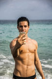 Shirtless Young Man Taking Selfie Photos at Beach Royalty Free Stock Photo