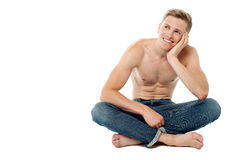 Shirtless young man thinking something Royalty Free Stock Photography
