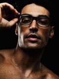 Shirtless young man wearing spectacles Stock Photo