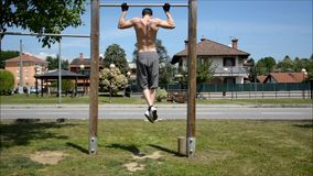 Shirtless young man working out outdoor stock footage