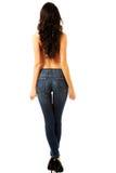 Shirtrless-Frau, die in den Jeans zurück zu Kamera steht Lizenzfreie Stockfotos