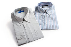 Shirts. Two pieces of folded stripe shirts on white background stock photography