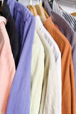 Shirts. In closet on hanger in different colors royalty free stock photos