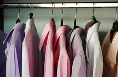 Shirts. Many shirts in the closet royalty free stock photography