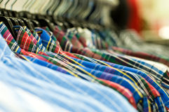 Shirts. Picture of different shirts on hangers Stock Photography