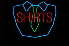 Shirts. Neon sign at a dry cleaning business advertising shirts stock image