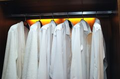 Shirts. Some white shirts in the garderobe Stock Images