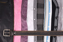 Shirts and a belt. Background from different shirts and a belt Royalty Free Stock Photography
