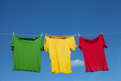Shirts on clothesline. Royalty Free Stock Photos
