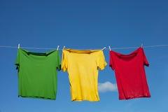 Shirts on clothesline. Royalty Free Stock Photos