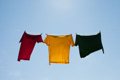 Shirts on clothesline. Stock Photos