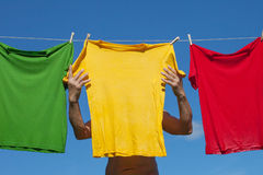 Shirts on clothesline. Stock Images