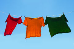 Shirts on clothesline. Royalty Free Stock Image