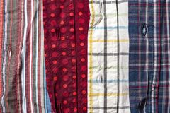 Shirts of different colors and patterns are next to each other stock images