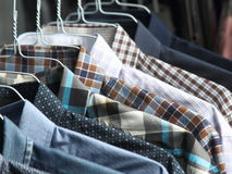 Shirts at the dry cleaners freshly ironed. Las camisas estan en perchas royalty free stock photography