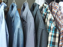 Shirts at the dry cleaners freshly ironed Royalty Free Stock Images