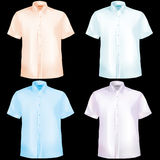 Shirts with half sleeves. Shirts in blue,green,purple and orange with half sleeves and buttons and collars Royalty Free Stock Photos