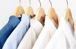 Shirts on hangars. Concept that could be used for neatness, closet, store display or dry cleaners Stock Image
