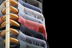 Shirts on hangers Stock Photos