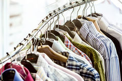 Shirts on hangers. In the store Royalty Free Stock Photo
