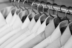 Shirts on hangers. At the show, shallow DOF, b&w version Stock Image