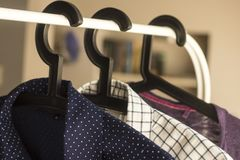 Shirts on hangers. royalty free stock photos