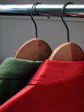 Shirts on hangers: Christmas colors Royalty Free Stock Photography