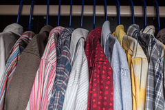 Shirts on hangers. Multi-colored shirts on hangers royalty free stock photography