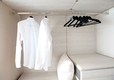 Shirts hanging on built-in cloths racks Stock Photography