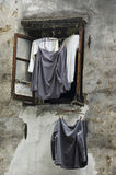 Shirts hanging from a chinese window Royalty Free Stock Photography