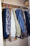 Shirts hanging in a closet Royalty Free Stock Images