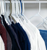 Shirts hanging in closet Stock Photos