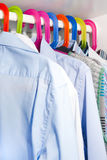 Shirts Hanging On Colourful Hangers Stock Photos
