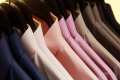 Shirts hanging on a hanger. Background of shirts hanging on a hanger Royalty Free Stock Photo