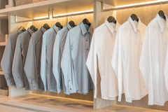 Shirts hanging on rack with white buttons Stock Photography