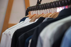 Shirts hanging at shop | men wear garment business Stock Images