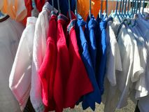 Shirts from linen on hangers. Outdoor sunlight Royalty Free Stock Photos