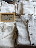 Shirts Made From Pure Undyed Hemp Fibres. Shirts at street stall,  Milan, made from pure cannabis,  hemp, pura canapa, fibres Stock Photo