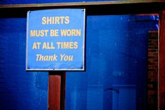Shirts must be worn at all times - Thank You sign Royalty Free Stock Photos