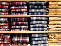 Shirts neatly on the shelf. All kinds of Shirts neatly on the shelf in a shop Royalty Free Stock Images