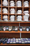 Shirts, neckties and hand cuff links displayed on shelves Stock Image