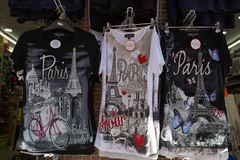 Shirts with Paris logo on sale in Montmartre souvenir shop in Paris, France. stock images