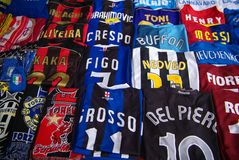 Shirts of players. Replicas of the original players' shirts on sale outside the stadiums Stock Images
