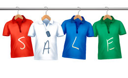 Shirts with price tags hanging on hangers. Stock Photography