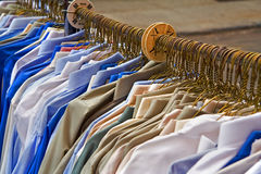 Shirts for sale. Rack of men's shirts set up for sidewalk sale stock photo