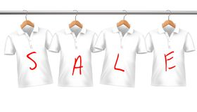 Shirts on sale hanging on hangers. Stock Photo